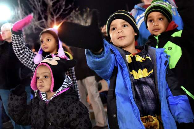 Ayden Cooper, 5, of Schenectady, center, waves to participates during the 48th Annual Daily Gazette Holiday Parade on Saturday, Nov. 21, 2015, in Schenectady, N.Y. (Cindy Schultz / Times Union) Photo: Cindy Schultz / 00033960A