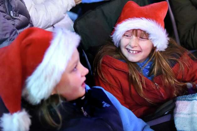 Genevieve Glunk, 9, right, and her friend Gretchen Elliott, 9, both of Guilderland, watch the fun during the 48th Annual Daily Gazette Holiday Parade on Saturday, Nov. 21, 2015, in Schenectady, N.Y. (Cindy Schultz / Times Union) Photo: Cindy Schultz / 00033960A