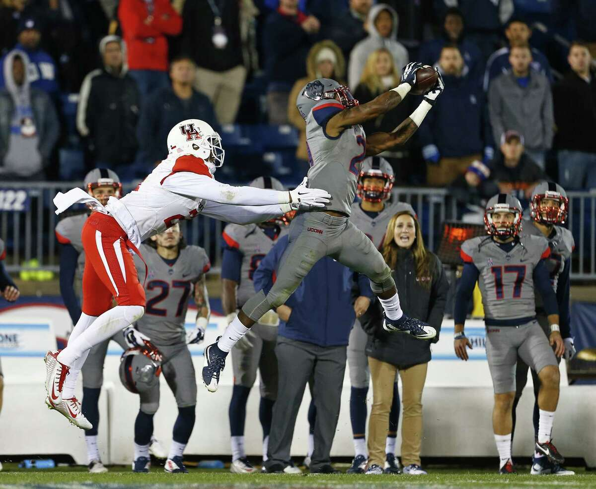 EAST HARTFORD, CT - NOVEMBER 21: Jamar Summers #21 of the Connecticut Huskies intercepts a pass intended for Chance Allen #21 ending the Cougars final drive during the fourth quarter at Rentschler Field on November 21, 2015 in East Hartford, Connecticut. The Huskies defeated the Cougars 20-17.