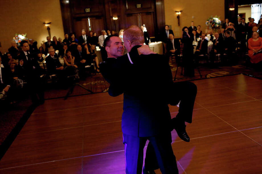 Vic Holmes (left) and Mark Phariss have their first dance as a married couple during their wedding reception at the Westin Stonebriar in Frisco. The couple said they took lessons twice a week for six months at a dance school. Photo: Photos By Lisa Krantz /San Antonio Express-News / SAN ANTONIO EXPRESS-NEWS