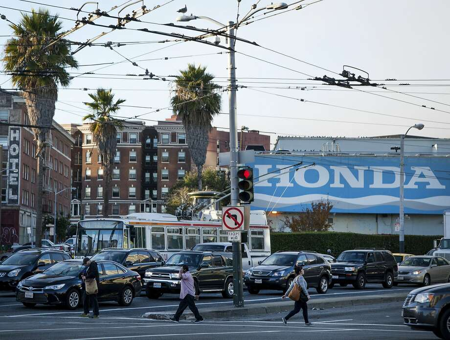 Pedestrians cross the street near the Civic Center Hotel (left) and San Francisco Honda, a formerly dreary area known as the Hub that now offers hopes for affordable housing. Photo: Santiago Mejia, Special To The Chronicle
