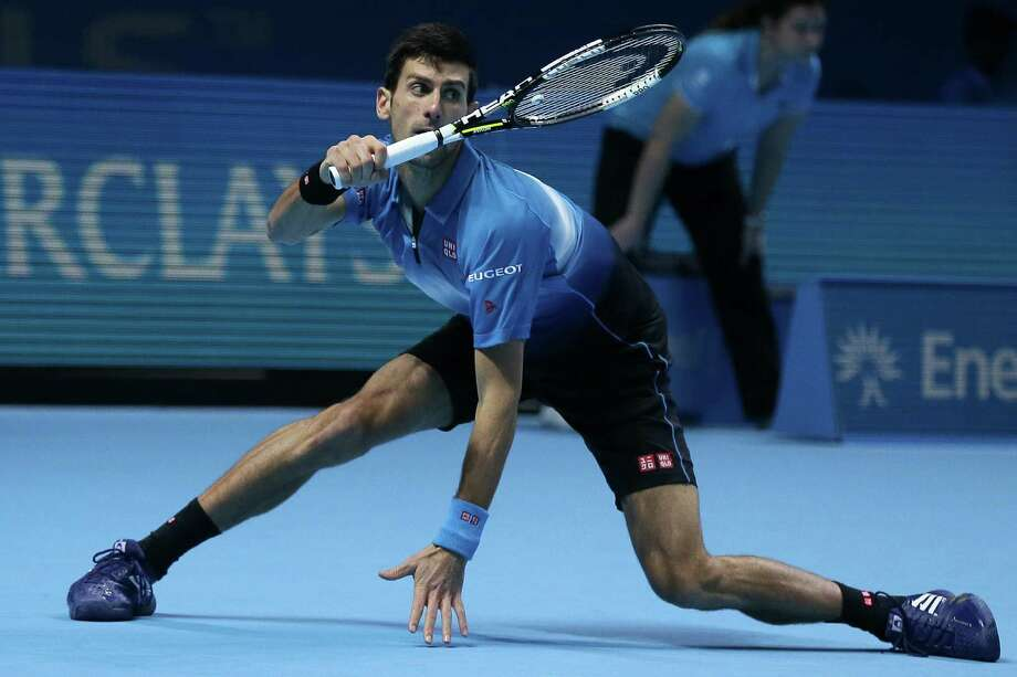 Serbia's Novak Djokovic plays a return to Spain's Rafael Nadal during their ATP World Tour Finals semifinal tennis match at the O2 Arena in London, Saturday Nov. 21, 2015. (AP Photo/Tim Ireland) Photo: Tim Ireland, STR / AP