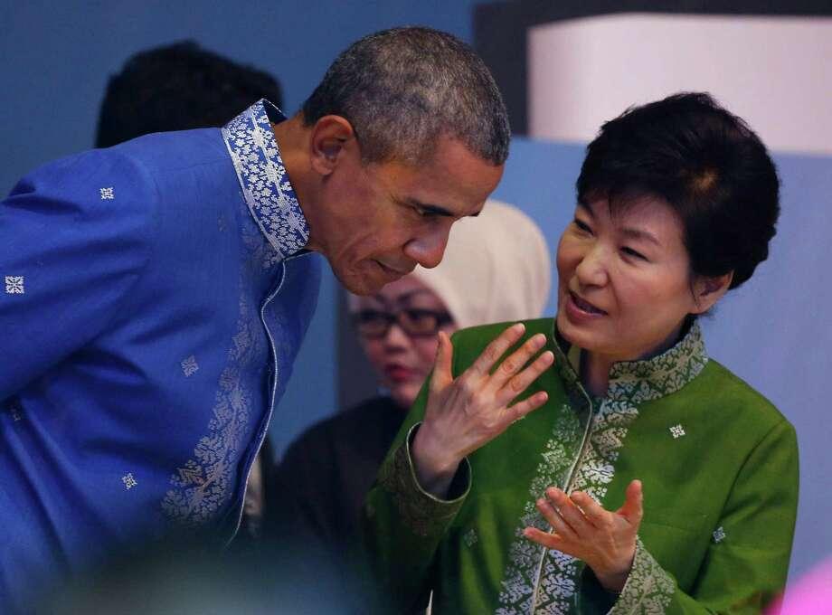 U.S. President Barack Obama, left, listen to South Korean President Park Geun-hye before the start of Gala Dinner during the ASEAN Summit in Kuala Lumpur, Malaysia on Saturday, Nov. 21, 2015.  (AP Photo/Vincent Thian) Photo: Vincent Thian, STF / AP