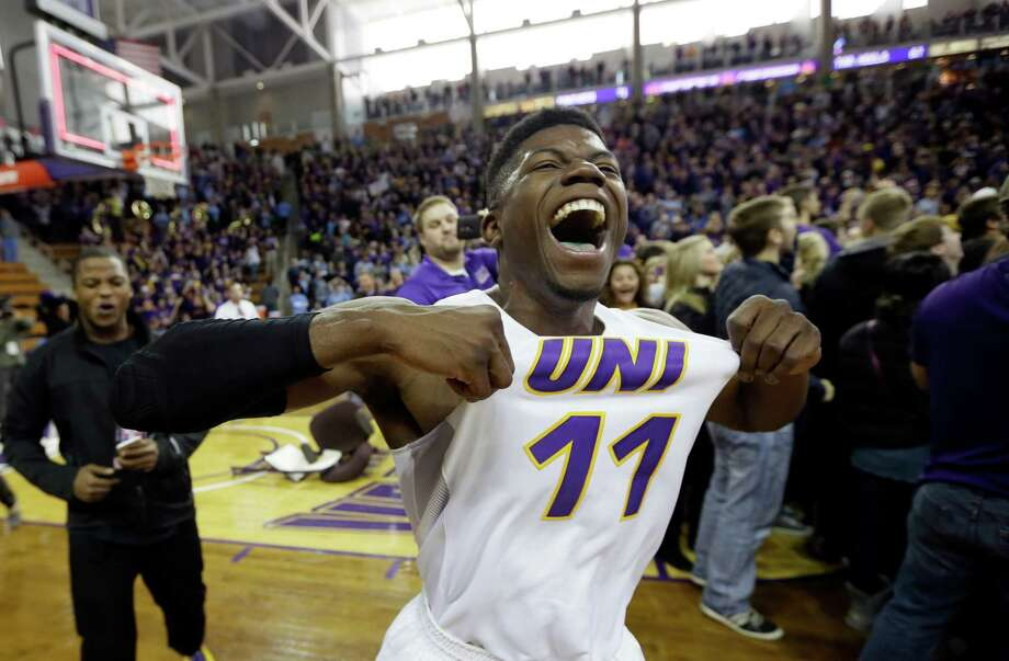 Northern Iowa guard Wes Washpun, who scored 21 points, joins the fun after he and his teammates knocked off top-ranked North Carolina on Saturday. Photo: Charlie Neibergall, STF / AP