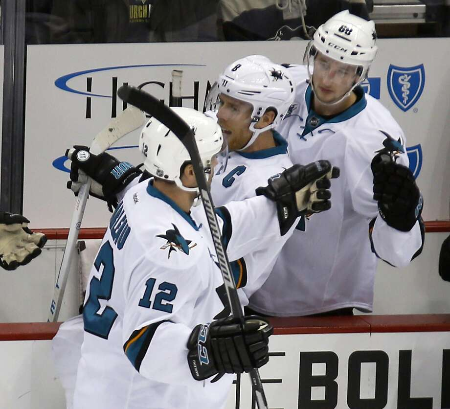 San Jose's Patrick Marleau (12) is greeted by Joe Pavelski and Melker Karlsson after his milestone. Photo: Keith Srakocic, Associated Press