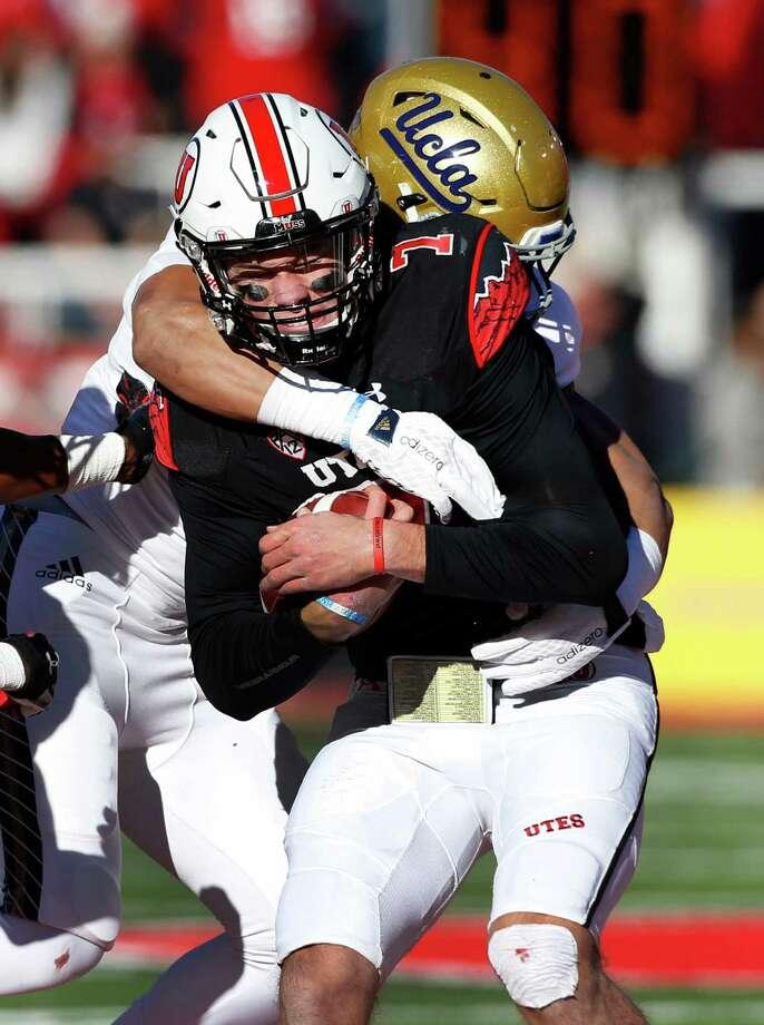 UCLA's Aaron Wallace sacks Travis Wilson in an upset of Utah. Photo: George Frey, Stringer / 2015 Getty Images