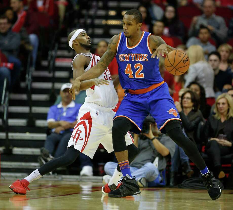 New York Knicks forward Lance Thomas (42) shoves Houston Rockets guard Corey Brewer (33) during the first half of an NBA basketball game at the Toyota Center on Saturday, Nov. 21, 2015, in Houston.  ( Karen Warren / Houston Chronicle ) Photo: Karen Warren, Staff / © 2015  Houston Chronicle