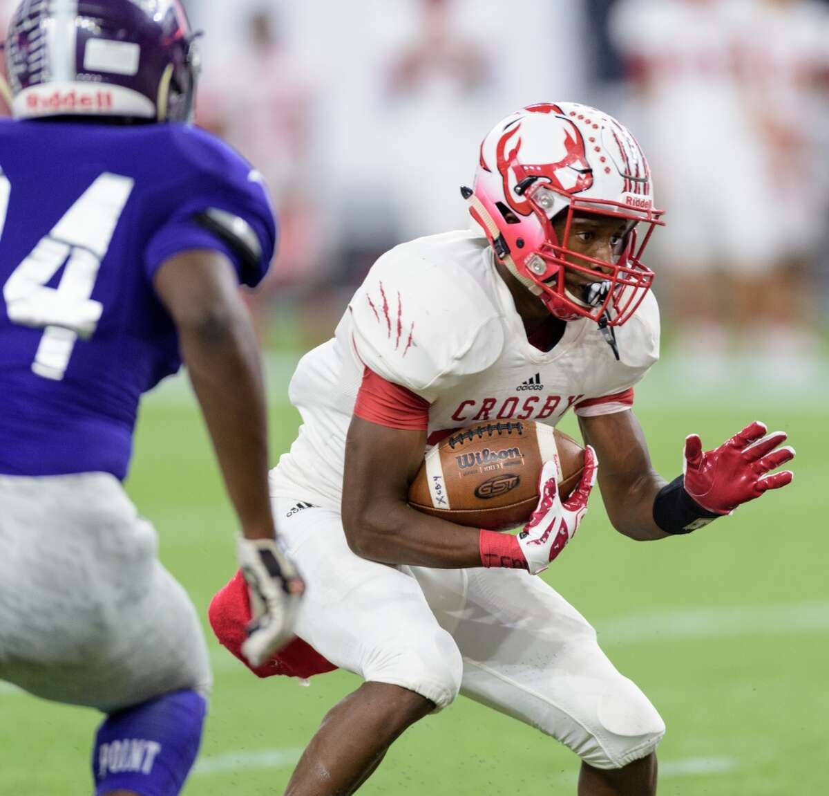 Craig Williams (21) of the Crosby Cougars runs up the middle in the first half against the Ridge Point Panthers in a high school football game on Saturday, November 21, 2015 at NRG Stadium.