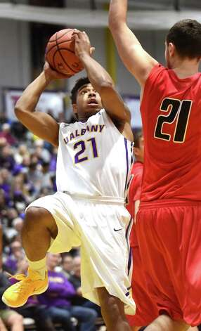 UAlbany's David Nichols, left, goes to the hoop as Oneonta's Dan Devine defends during their basketball game on Saturday, Nov. 21, 2015, at SEFCU Arena in Albany, N.Y. (Cindy Schultz / Times Union) Photo: Cindy Schultz / 00034277A
