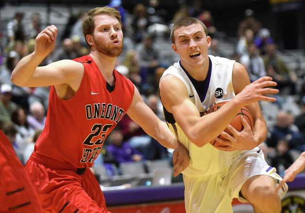 UAlbany's Joe Cremo, right, controls the ball as Oneonta's Tyler Levin defends during their basketball game on Saturday, Nov. 21, 2015, at SEFCU Arena in Albany, N.Y. (Cindy Schultz / Times Union) Photo: Cindy Schultz / 00034277A