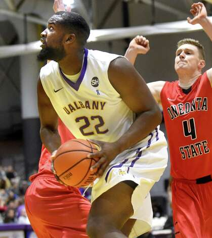 UAlbany's Richard Peters, left, looks to the hoop as Oneonta's Jack Dignan defends during their basketball game on Saturday, Nov. 21, 2015, at SEFCU Arena in Albany, N.Y. (Cindy Schultz / Times Union) Photo: Cindy Schultz / 00034277A