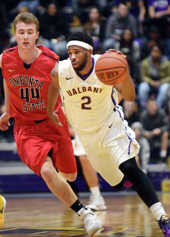 UAlbany's Jamir Andrews, right, drives up court as Oneonta's Myles Joyce defends during their basketball game on Saturday, Nov. 21, 2015, at SEFCU Arena in Albany, N.Y. (Cindy Schultz / Times Union) Photo: Cindy Schultz / 00034277A