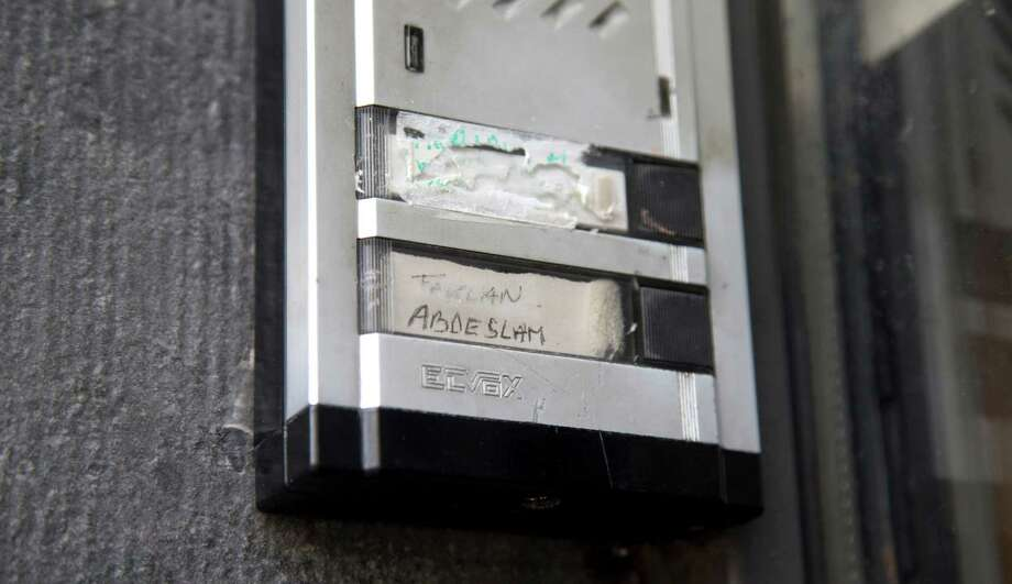 FILE - In this Wednesday, Nov. 18, 2015, file photo, the Abdeslam name is shown on the doorbell on the house of the family of Belgian militants Brahim and Salah Abdeslam in Molenbeek, Belgium. The family homes of the suspected mastermind of the Paris attacks and one of the suicide bombers stand only a few blocks apart in the Belgian capital's Molenbeek neighborhood. (AP Photo/Virginia Mayo, File) Photo: Virginia Mayo, STF / AP