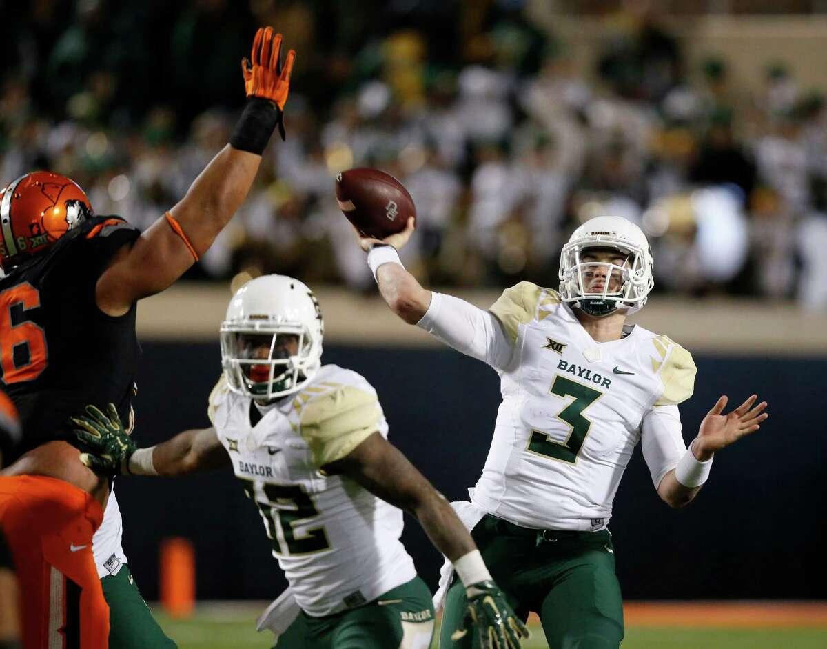 Baylor quarterback Jarrett Stidham (3) passes under pressure from Oklahoma State defender Lemaefe Galea'i during the second quarter of an NCAA college football game in Stillwater, Okla., Saturday, Nov. 21, 2015. (AP Photo/Sue Ogrocki)