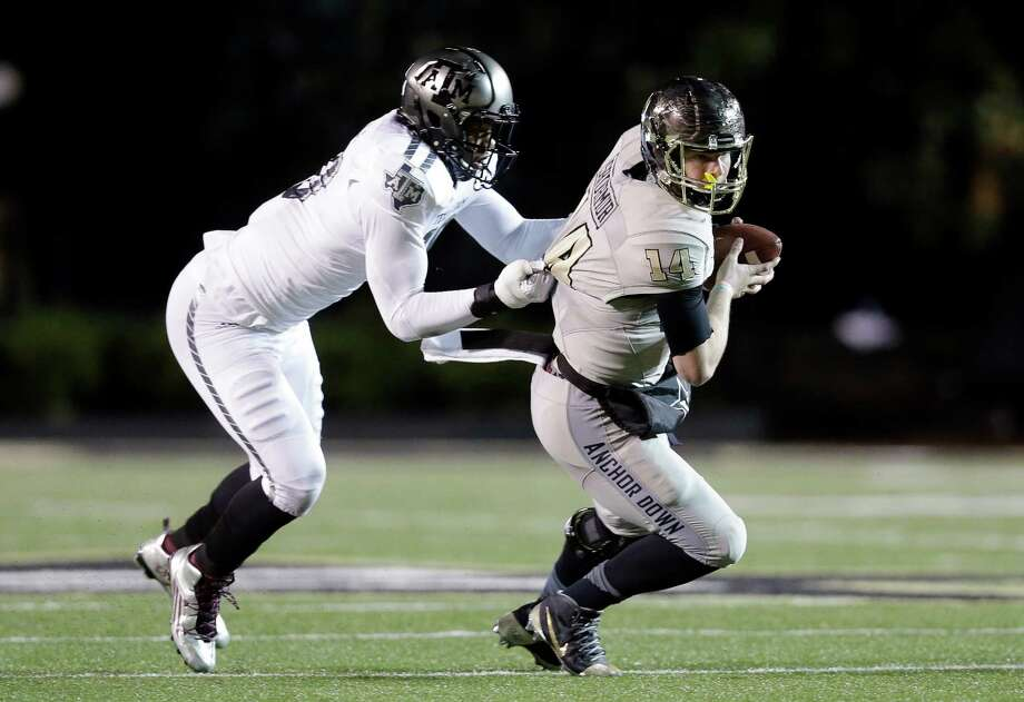 A&M's Daeshon Hall wraps up Vanderbilt quarterback Kyle Shurmur as part of a flawless defensive performance. Photo: Mark Humphrey, STF / AP