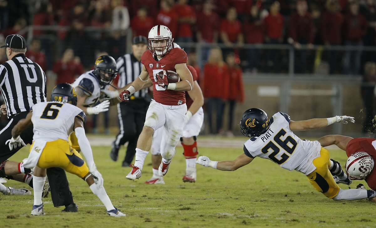 Stanford's Christian McCaffrey, on a first quarter run, as Stanford takes on California in the 118th Big Game at Stanford Stadium, on Sat. November 21, 2015, in Stanford, Calif.