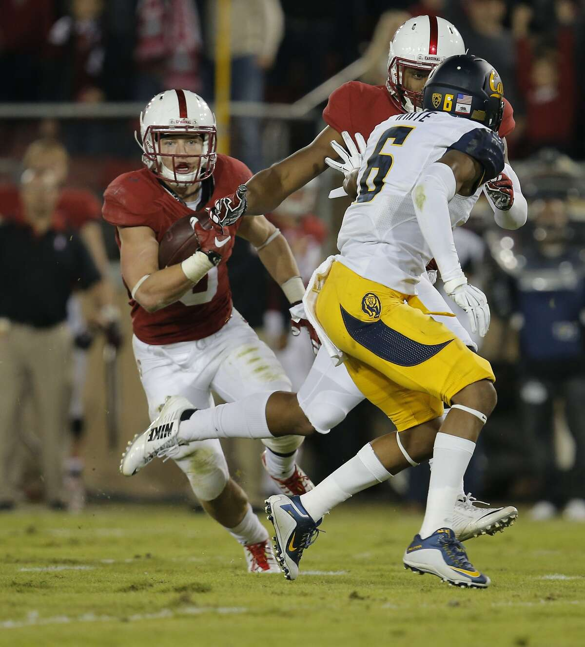 Stanford's Christian McCaffrey, 5 cuts across the field as he heads to the end zone on a fifty yard pass and run in the second quarter, as Stanford takes on California in the 118th Big Game at Stanford Stadium, on Sat. November 21, 2015, in Stanford, Calif.