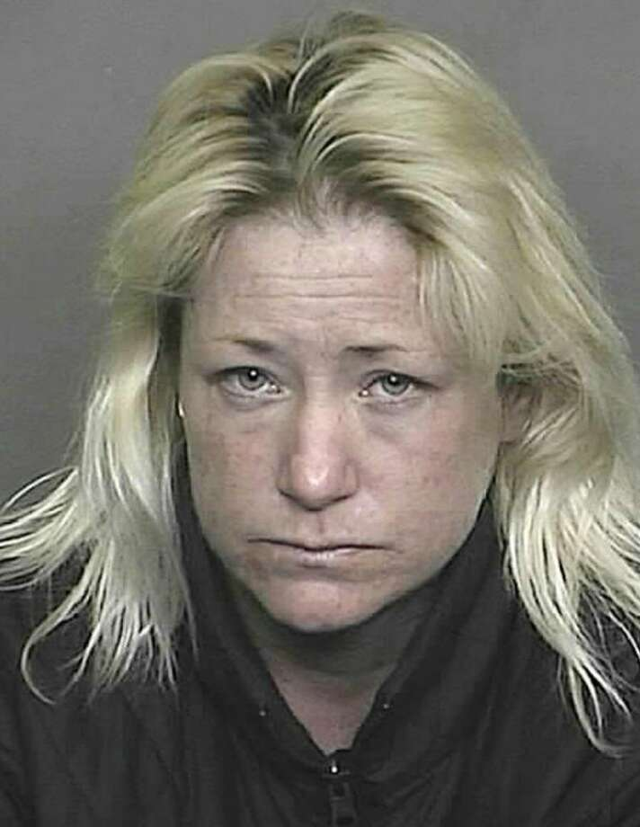 The trial has begun for Sandra Lee Jacobson, a Colorado woman shown in this January 2009 Denver police photo, who accused of driving drunk and killing two Greenwich librarians last year near the Denver airport. Photo: File Photo / Greenwich Time File Photo