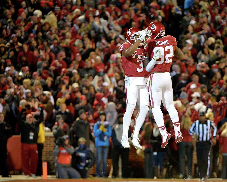 Oklahoma wide receiver Sterling Shepard (3) and running back Samaje Perine (32) celebrate Shepard's first-quarter touchdown against TCU at Oklahoma Memorial Stadium in Norman, Okla., on Saturday, Nov. 21, 2015. (Max Faulkner/Fort Worth Star-Telegram/TNS) Photo: Max Faulkner, MBR / Fort Worth Star-Telegram