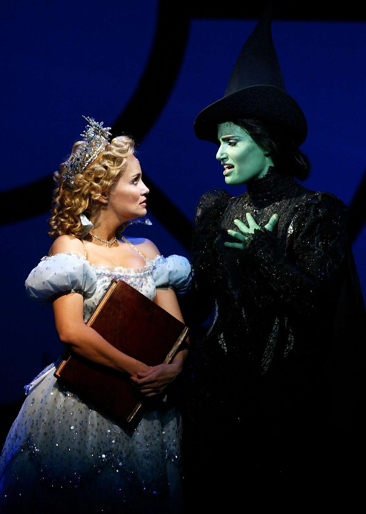 """(NYT20) NEW YORK -- May 10, 2004 -- TONY-NOMINEE-6 -- Kristin Chenowth, left, as Glinda and Idina Menzel as Elphaba in the musical """"Wicked"""" at the Gershwin Theater in Manhattan on October 8, 2003. """"Wicked,"""" the musical inspired by """"The Wizard of Oz"""" that delves into the past of the Wicked Witch of the West, captured 10 Tony Award nominations Monday morning, April 10, 1004, burying its competition somewhere under Auntie Em's house. (Sara Krulwich/The New York Times) ProductNameChronicle Tonya Pinkins in Caroline, or Change; Denis O'Hare, Michael Cerveris, James Barbour, Becky Ann Baker in Assassins; Jefferson Mays in I Am My Own Wife. Tonya Pinkins in Caroline, or Change; Denis O'Hare, Michael Cerveris, James Barbour, Becky Ann Baker in Assassins; Jefferson Mays in I Am My Own Wife. ProductNameChronicle"""