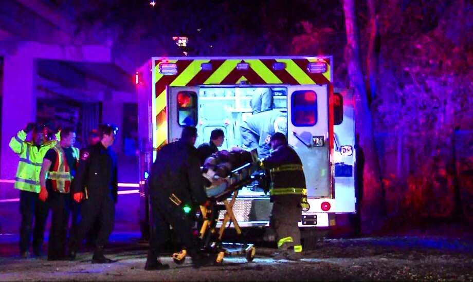 A woman is transported to San Antonio Military Medical Center in serious condition after falling from U.S. 281 down into the Olmos Basin. Photo: Courtesy Pro 21 Video, For MySA.com
