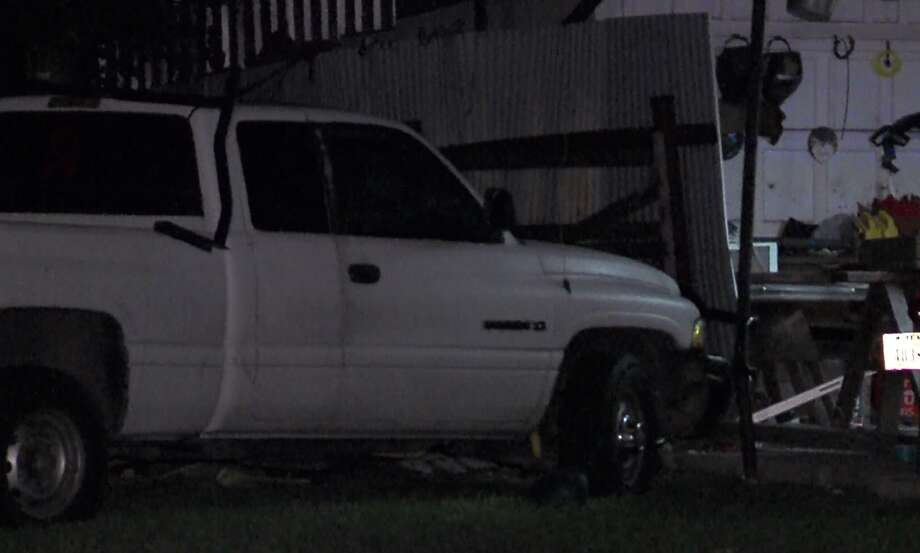 San Antonio Police say a man driving a vehicle as he was intoxicated collided with a parked vehicle before hitting a home at about 5:15 a.m. Sunday, Nov. 22, 2015, in the 2000 block of La Manda. Photo: Courtesy Pro 21 Video, For MySA.com