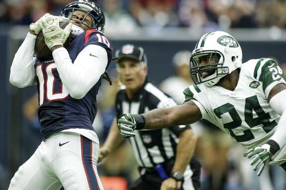 Houston Texans wide receiver DeAndre Hopkins (10) beats New York Jets cornerback Darrelle Revis (24) for a 61-yard touchdown reception during the second quarter of an NFL football game at NRG Stadium on Sunday, Nov. 22, 2015, in Houston. ( Brett Coomer / Houston Chronicle )