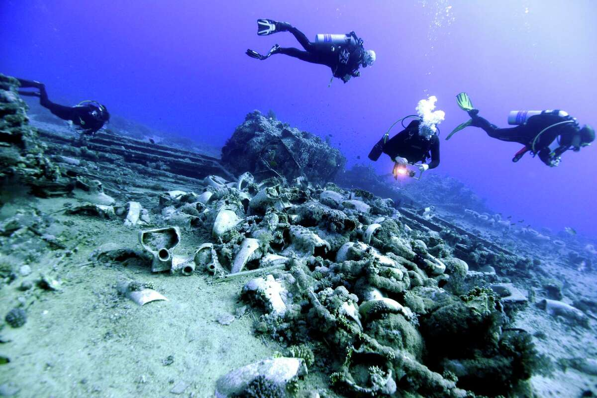 Divers explore a shipment of British toilets from the Yolanda wreck on November 9, 2015 in Red Sea, Egypt. Yolanda was a Cypriot cargo ship that grounded on Ras Muhammad reef in April 1980. From 1981 to 1985, the wreck was a popular driving site, but it was lost when it fell off the reef during a storm in 1985.The wreck now lies at a depth of 145 to 160 meters leaving only the cargo to be explored by recreational divers