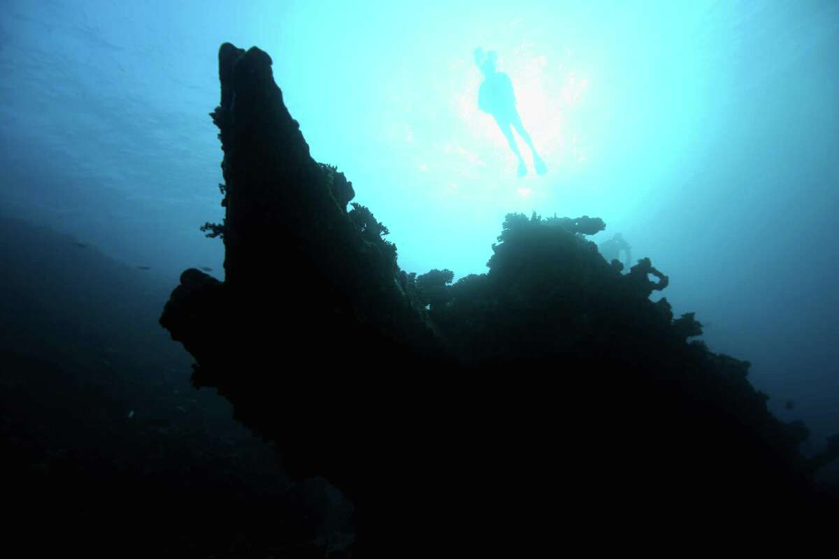A diver on the Bow of the Carnatic wreck on Abu Nuhas Reef on November 7, 2015 in The Red Sea, Egypt. The Carnatic was a British sail-steam cargo ship of 1,776 tonnes built in 1862. On 14 September 1869 she hit the reef and now lies on the north side of it in 27 meters of water