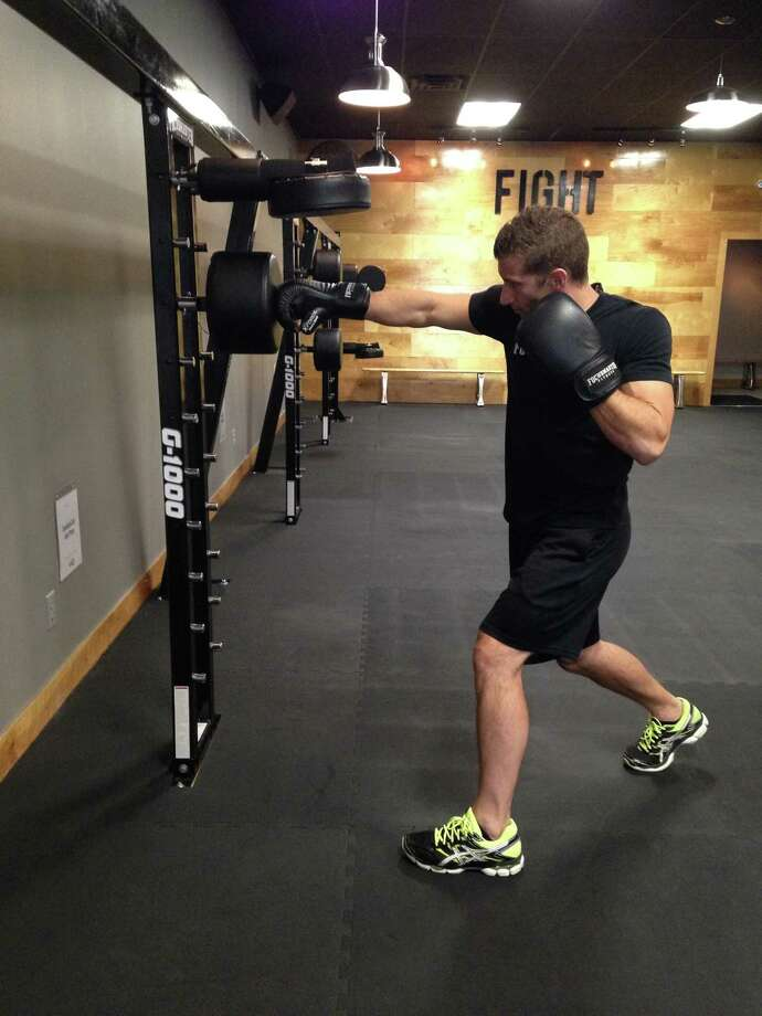 Kyle Coletti, owner and creator of Focusmaster Fitness in Troy and Loudonville, demonstrates a right front cross punch. (Carin Lane)