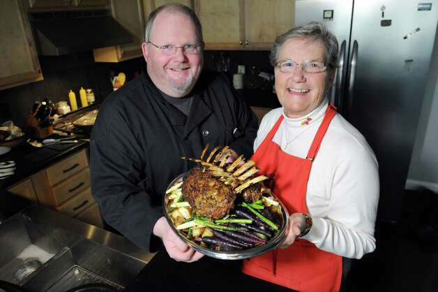 Steve Barnes and his mother Karen Barnes with a rack of lamb on Saturday, Oct. 24, 2015, in Albany, N.Y. (Cindy Schultz / Times Union) Photo: Cindy Schultz / 10033901A