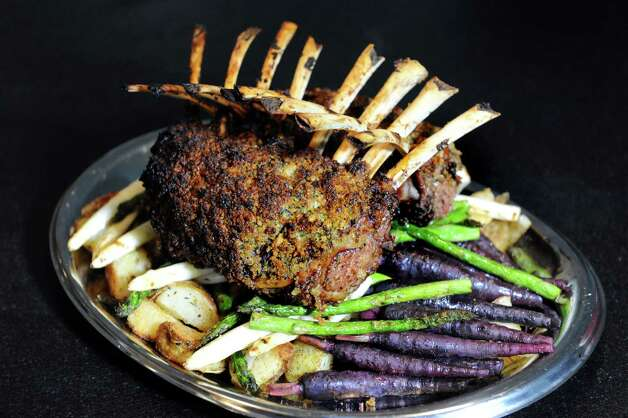 Rack of lamb on Saturday, Oct. 24, 2015, at the home of Steve Barnes in Albany, N.Y. (Cindy Schultz / Times Union) Photo: Cindy Schultz / 10033901A