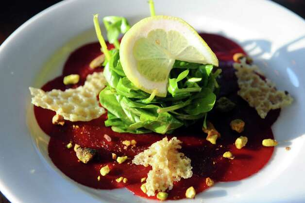 Beet carpaccio at The Flammerie on Wednesday Feb. 25, 2015 in Kinderhook, N.Y. (Michael P. Farrell/Times Union) Photo: Michael P. Farrell / 00030744A