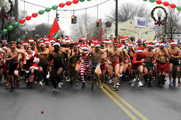 Participants break from the starting line during the 2012 Santa Speedo run on Lark Street in Albany, NY Saturday Dec. 8, 2012. (Michael P. Farrell/Times Union) Photo: Michael P. Farrell / 00020321A