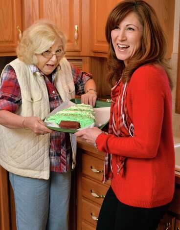 Kelly Lynch Wyland, right and her mother Donna Lynch with a Christmas tree-shaped cake in Kelly's kitchen Friday Nov. 6, 2015 in Colonie, NY.  (John Carl D'Annibale / Times Union) Photo: John Carl D'Annibale / 00033963A