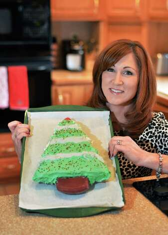 Kelly Lynch Wyland with a Christmas tree-shaped cake in her kitchen Friday Nov. 6, 2015 in Colonie, NY.  (John Carl D'Annibale / Times Union) Photo: John Carl D'Annibale / 00033963A