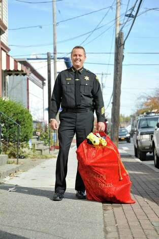 Albany County Sheriff Craig Apple poses with a bag of Christmas toys on Quail Street on Tuesday, Oct. 27, 2015, in Albany, N.Y.     (Paul Buckowski / Times Union) Photo: PAUL BUCKOWSKI / 00033944A