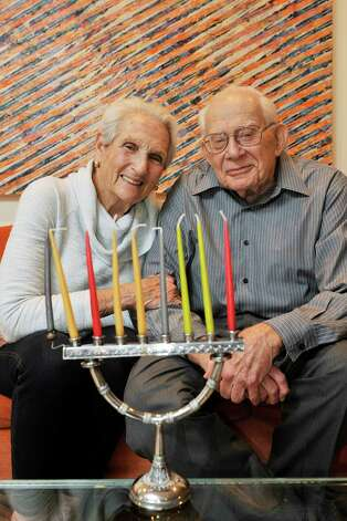 Anne Rosenfeld and her husband, Harry Rosenfeld, pose with their menorah at their home on Monday, Oct. 26, 2015, in Albany, N.Y. (Paul Buckowski / Times Union) Photo: PAUL BUCKOWSKI / 10033904A
