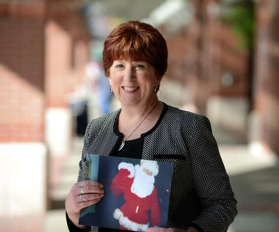 Albany Mayor Kathy Sheehan holds a picture of her father dressed as Santa as she stands for a photo at Albany International Airport Monday afternoon, Nov. 2, 2015, in Colonie, N.Y. (Will Waldron/Times Union) Photo: Will Waldron / 00034007A