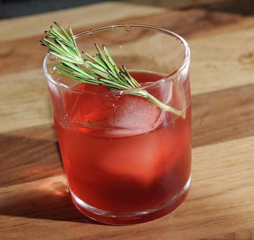 A Hibiscus Negroni holiday cocktail at Peck's Arcade Friday, Oct. 16, 2015 in Troy, N.Y. See below for recipe. (Lori Van Buren / Times Union) Photo: Lori Van Buren / 10033774A