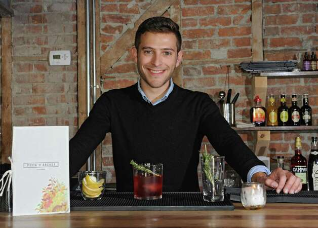 Guy Ladouceur with his Hibiscus Negroni holiday cocktail at Peck's Arcade Friday, Oct. 16, 2015 in Troy, N.Y. (Lori Van Buren / Times Union) Photo: Lori Van Buren / 10033774A