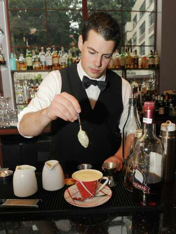 Bartender Michael Moscatiello makes the Tom & Jerry cocktail at DP on Thursday Oct. 22, 2015 in Albany, N.Y.  (Michael P. Farrell/Times Union) Photo: Michael P. Farrell / 10033846A