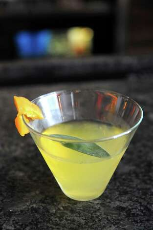 The La Remolacha coctail made by bartender Amanda Houghtaling at Ama Cocina on Thursday Oct. 22, 2015 in Albany, N.Y. See recipe below. (Michael P. Farrell/Times Union) Photo: Michael P. Farrell / 10033845A