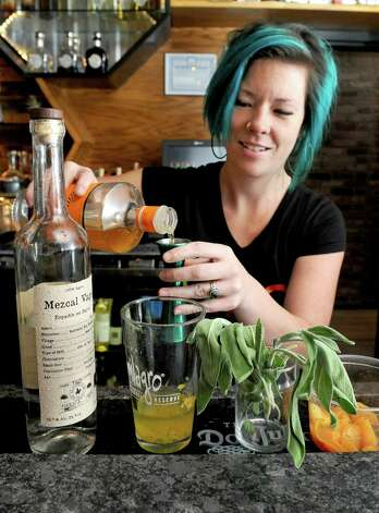 Bartender Amanda Houghtaling makes her La Remolacha coctail at Ama Cocina on Thursday Oct. 22, 2015 in Albany, N.Y.  (Michael P. Farrell/Times Union) Photo: Michael P. Farrell / 10033845A
