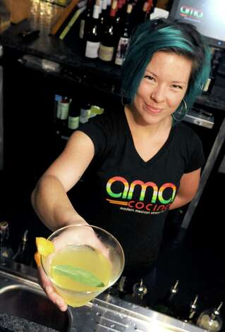 Bartender Amanda Houghtaling with her La Remolacha coctail at Ama Cocina on Thursday Oct. 22, 2015 in Albany, N.Y.  (Michael P. Farrell/Times Union) Photo: Michael P. Farrell / 10033845A