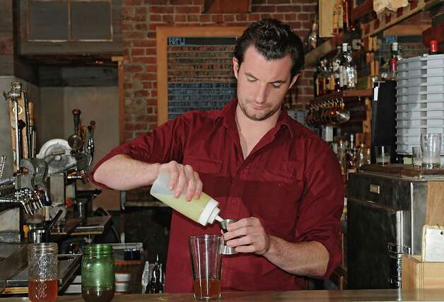 Bartender Paul Diederick makes a winter spiced side sleigh holiday cocktail at The Shop on Friday, Oct. 16, 2015 in Troy, N.Y. (Lori Van Buren / Times Union) Photo: Lori Van Buren / 10033776A