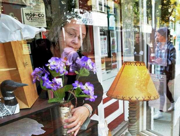 Gallery manager Laurie Longfield arranges a window display at New York Folklore Society at Jay Street Market Place Tuesday Oct. 27, 2015 in Schenectady, NY.  (John Carl D'Annibale / Times Union) Photo: John Carl D'Annibale / 10033918A