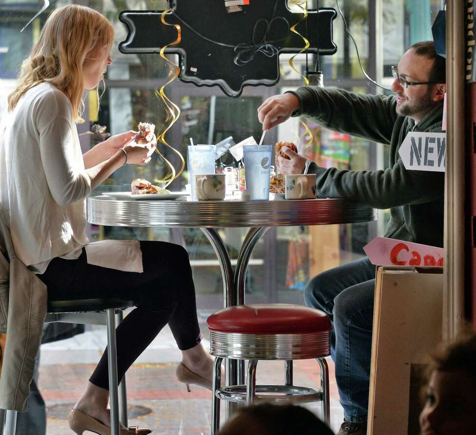 Friends Leah Thompson, left, of Albany and Matthew Lundy of Rotterdam lunch at Ambition Coffee House and Eatery at Jay Street Market Place Tuesday Oct. 27, 2015 in Schenectady, NY. (John Carl D'Annibale / Times Union)