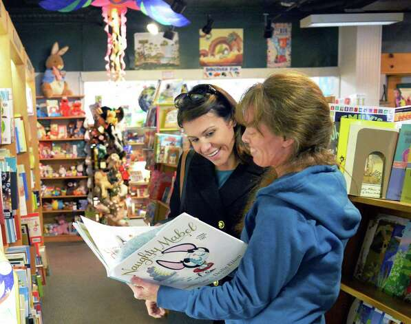 Pam Barnhart, left, of Malta, gets some help hop from children's book buyer Kathleen Kemp in The Open Door book store at Jay Street Market Place Tuesday Oct. 27, 2015 in Schenectady, NY.  (John Carl D'Annibale / Times Union) Photo: John Carl D'Annibale / 10033918A