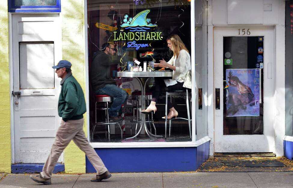 Friends Matthew Lundy of Rotterdam and Leah Thompson, right, of Albany lunch in a window seat in Ambition Coffee House and Eatery at Jay Street Market Place Tuesday Oct. 27, 2015 in Schenectady, NY. (John Carl D'Annibale / Times Union)